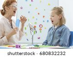 Small photo of School counselor during speech and language rehabilitation with small girl