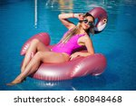 beautiful blonde swimming in... | Shutterstock . vector #680848468