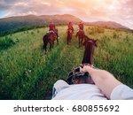 male rider on horseback holds a ... | Shutterstock . vector #680855692