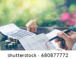 coins stack in front of bank... | Shutterstock . vector #680877772