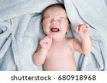 crying newborn baby boy lying... | Shutterstock . vector #680918968