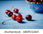 cherries scattered on a blue... | Shutterstock . vector #680921065