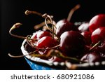 cherry in a blue bowl close up... | Shutterstock . vector #680921086