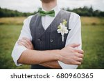 groom in a waistcoat and bow... | Shutterstock . vector #680960365