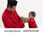 malay family  father and son | Shutterstock . vector #680963548