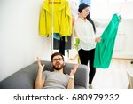 bored husband waiting for wife | Shutterstock . vector #680979232