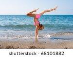 Schoolgirl Making Gymnastics O...