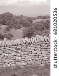 Small photo of Countryside and Stone Wall, Broadway; Worcestershire; England; UK in Black and White Sepia Tone