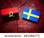 Small photo of Angolan flag with Swedish flag on a tree stump isolated