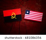 Small photo of Angolan flag with Liberian flag on a tree stump isolated