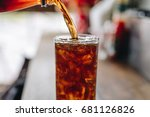 pouring cola water into the... | Shutterstock . vector #681126826