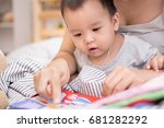 close up of little baby while... | Shutterstock . vector #681282292