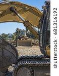 a bulldozer is seen through a... | Shutterstock . vector #681316192