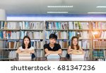 Small photo of Young students asian together group teenager smiler reading book at high school university campus college library knowledge center for learning bright idea in summer holiday.