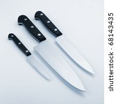 Three kitchen knives. Blue toned - stock photo