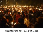 EDINBURGH - DECEMBER 30: people take part in a torchlight procession on December 30, 2010 in Edinburgh, Scotland. The torchlight procession is an annual event to celebrate the end of the year. - stock photo