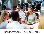two smiling couples sitting at...   Shutterstock . vector #681532288