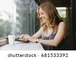 young woman using new... | Shutterstock . vector #681533392