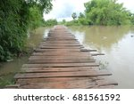 old wooden bridge in countryside | Shutterstock . vector #681561592