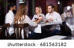 happy  people enjoying food in... | Shutterstock . vector #681563182