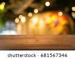 empty dark wooden table in... | Shutterstock . vector #681567346