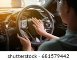 woman pressing the horn while... | Shutterstock . vector #681579442