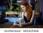 woman in a cafe having a rest... | Shutterstock . vector #681625366