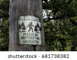 Stock photo please do not feed the sasquatch sign posted on a tree rocky mountain national park 681738382