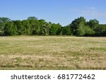 open field with trees on the... | Shutterstock . vector #681772462