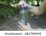 Sporty Girl Opens A Bottle Of...