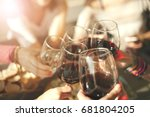 cheers with glasses of red wine | Shutterstock . vector #681804205