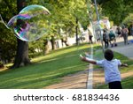 child with huge bubbles | Shutterstock . vector #681834436