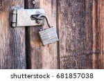 broken lock on a wooden door | Shutterstock . vector #681857038