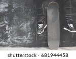 Boy Skater Is Sitting On The...