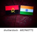 Small photo of Angolan flag with Indian flag on a tree stump isolated