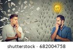side profile of two serious... | Shutterstock . vector #682004758