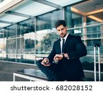 young businessman waiting and... | Shutterstock . vector #682028152