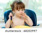 eating baby girl | Shutterstock . vector #68202997