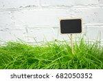 slate topper in green grass | Shutterstock . vector #682050352