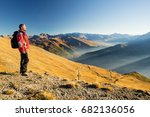 male hiker relaxing at sunset... | Shutterstock . vector #682136056