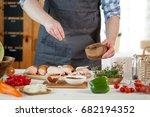 male preparing chicken for... | Shutterstock . vector #682194352