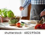 male cooking healthy salad | Shutterstock . vector #682195636