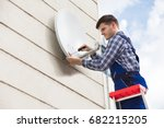 young male technician in... | Shutterstock . vector #682215205