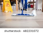janitor cleaning floor in front ... | Shutterstock . vector #682231072