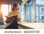 elegant young woman looking...   Shutterstock . vector #682303735