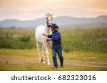 cowboy with the horse on the... | Shutterstock . vector #682323016