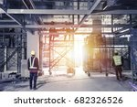 workers  in safety protective... | Shutterstock . vector #682326526