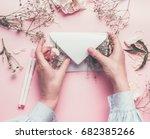 women hands holding paper... | Shutterstock . vector #682385266