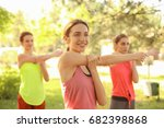 group of young women practicing ... | Shutterstock . vector #682398868