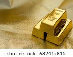 Three Pieces Of Gold Bars On A...